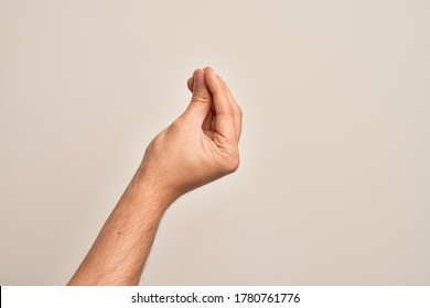 Hand of caucasian young man showing fingers over isolated white background doing Italian gesture with fingers together, communication gesture movement