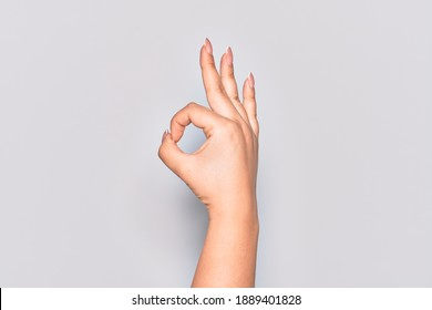 Hand of caucasian young woman gesturing approval expression doing okay symbol with fingers