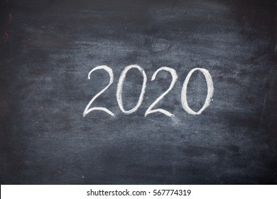 Hand chalk drawing 2020 on black board with copy space