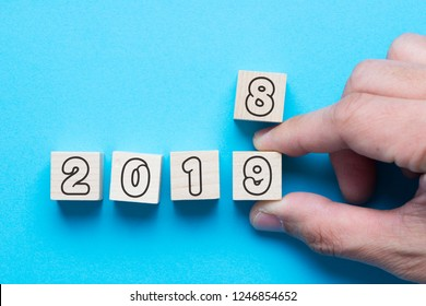 Hand is changing a wooden cube from 2018 to 2019 for new year count down concept
