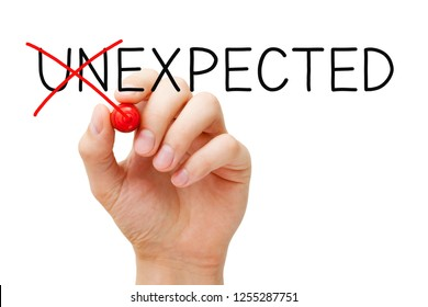 Hand changing the word Unexpected into Expected with red marker isolated on white. Expect the Unexpected concept.