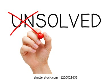 Hand changing the word Unsolved into Solved with red marker isolated on white in solution concept.