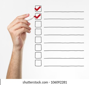 Hand checking the checklist boxes