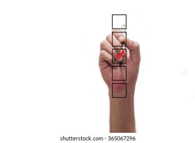 Hand checking mark on checklist with marker.