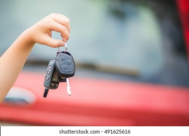 Hand of the child holds the car keys
