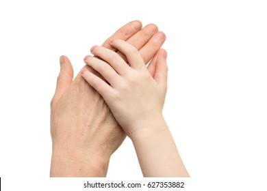 Hand of a child lies on the mother hand isolated on a white background