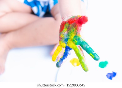 Hand of childhood he is education paint color on hand, this is fingerpaint color