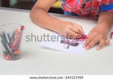 Hand Children Coloring With Crayons