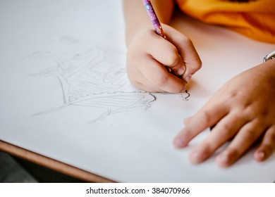 Hand of children drawing with pencil