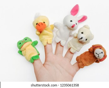 hand of children playing animals fingers puppet isolated on blackground.