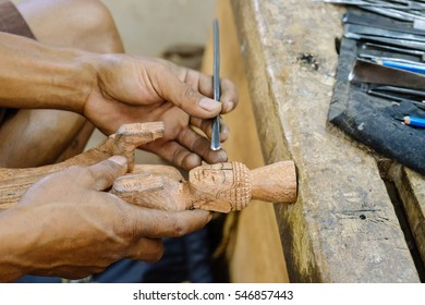 hand chisel carving buddha wooden