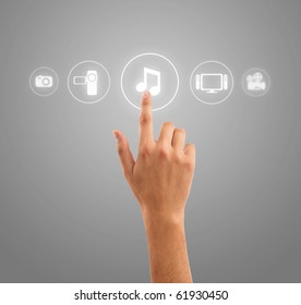 hand choosing music note symbol from media icons