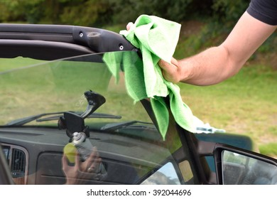 hand cleaning the car.