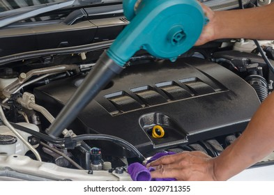 Hand Cleaning Car Engine