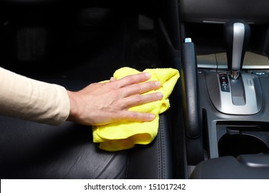 Hand cleaning car seat.