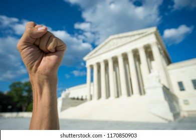Hand clenched in fist symbol as sign of protest in front of US Supreme Court building in Washington DC