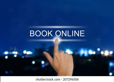 hand clicking book online button on a touch screen interface