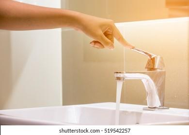 hand close water tap. Selective focus
