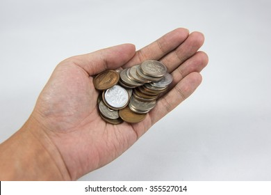 A hand of coins in the palm
