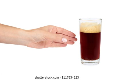 Hand with cold glass of dark beer or kvass with foam isolated on white background
