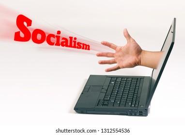 Hand coming out of computer pushi'ng Socialism.
