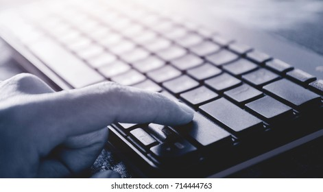 hand with computer keyboard for background.