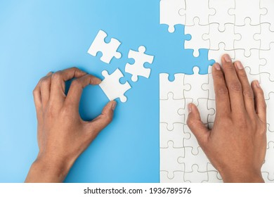 Hand connect jigsaw parts with word problem, solution.   symbol of association and connection. business strategy. Teamwork concept.