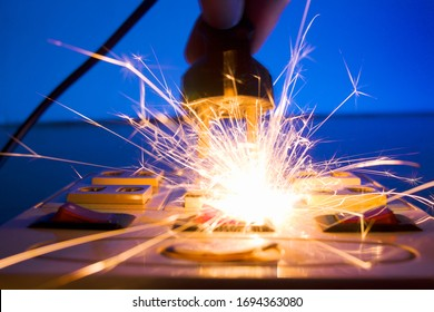 Hand connecting electrical plug cause electric shock, Idea for causes of home fire, Electric short circuit, Electrical hazard can ignite household items