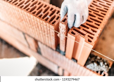 hand of construction worker completing interior walls, building details