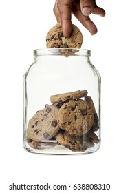Hand in cookie jar isolated on white