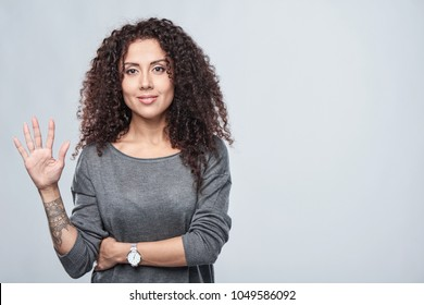 Hand counting - five fingers. Smiling woman showing five fingers
