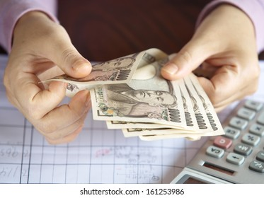 Hand counting money, Japanese currency note , Japanese yen