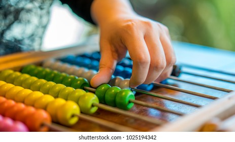 Hand counting on colorful abacus