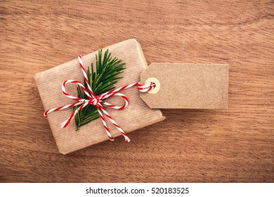 Hand crafted chrismas or thanksgiving gift with blank label on wooden background, copy space.
