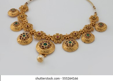 Hand Crafted Gold Necklace Jewellery on a white background.