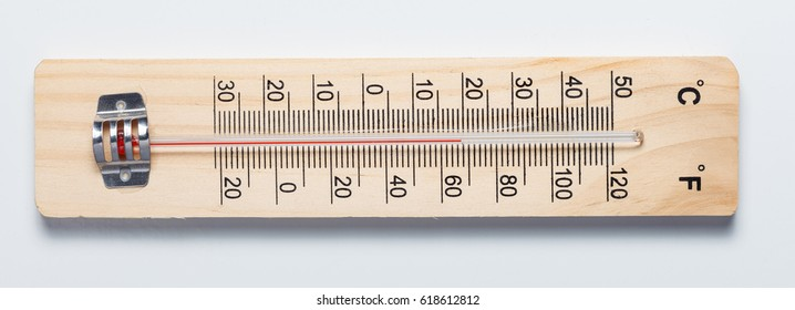 Hand crafted old wooden thermometer isolated on white background