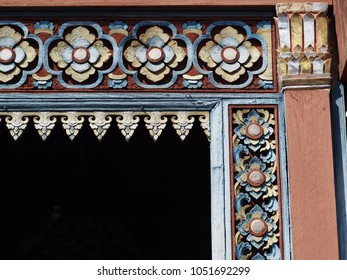 hand crafted work of THAI artist on a vintage hardwood temple door frame showing typical traditional northern THAILAND style pattern ornaments and technique for buddhism temple decoration crop closeup