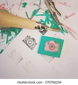 Hand crafting rubber stamps.