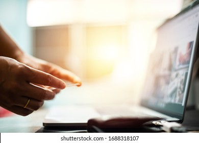 Hand with credit card with laptop in shopping online concept.