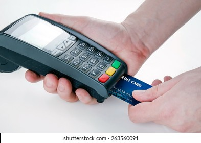 Hand with credit card swipe through terminal for sale