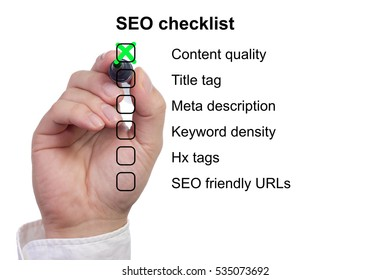 Hand crossing off items from a SEO checklist isolated on white