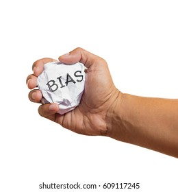 "Hand crumpled paper with the message ""bias"""