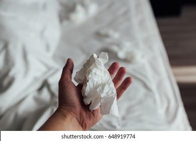 Hand with crumpled tissue paper. Man masturbate concept. finish sex.