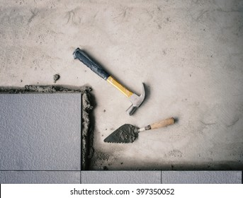 hand cut floor tile installation(Filtered image processed vintage effect )