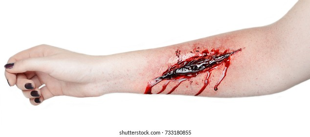 a hand is cut vein a lot of blood flowing red body wound pain suturing wound suicide photo on white background professional make-up artist draws special effects for film make-up