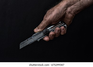 hand with cutting knife