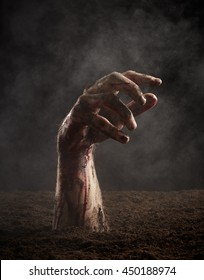 Hand of dead in blood and dirt