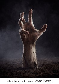 Hand of dead climbs out of the ground