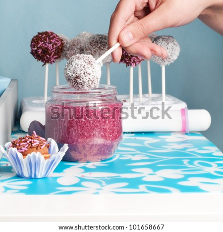 hand decorating cakepops and cupcakes