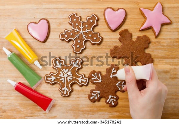 Hand Decorating Christmas Gingerbread Snowflakes Biscuits Stock